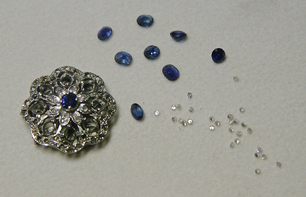 Clients brooch with stones for earrings removed.  Remaining central section of brooch will be made into a ring
